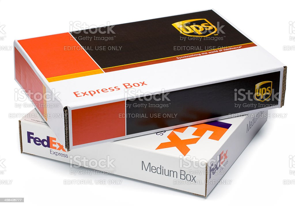 Clipping Path. UPS and FEDEX boxes. stock photo