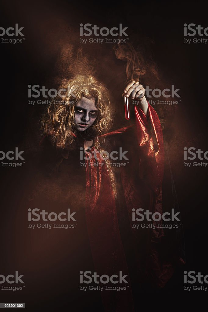 cloaked witch stock photo