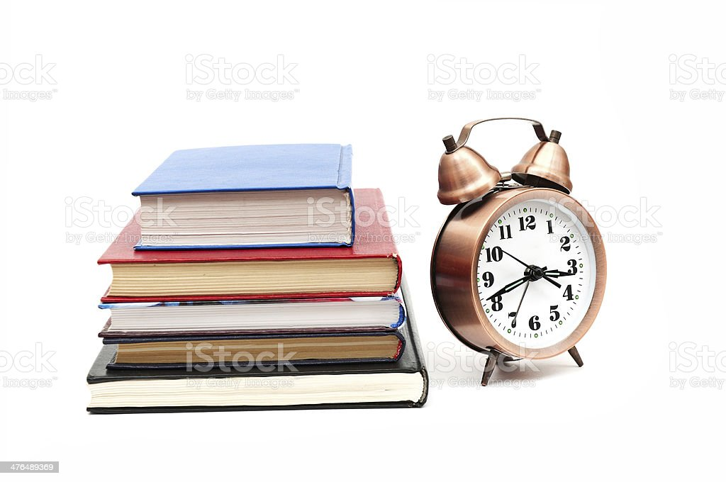 clock and books royalty-free stock photo