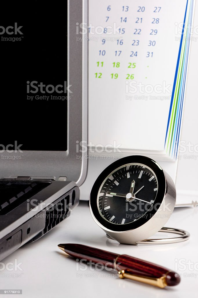 Clock and calendar business concept stock photo