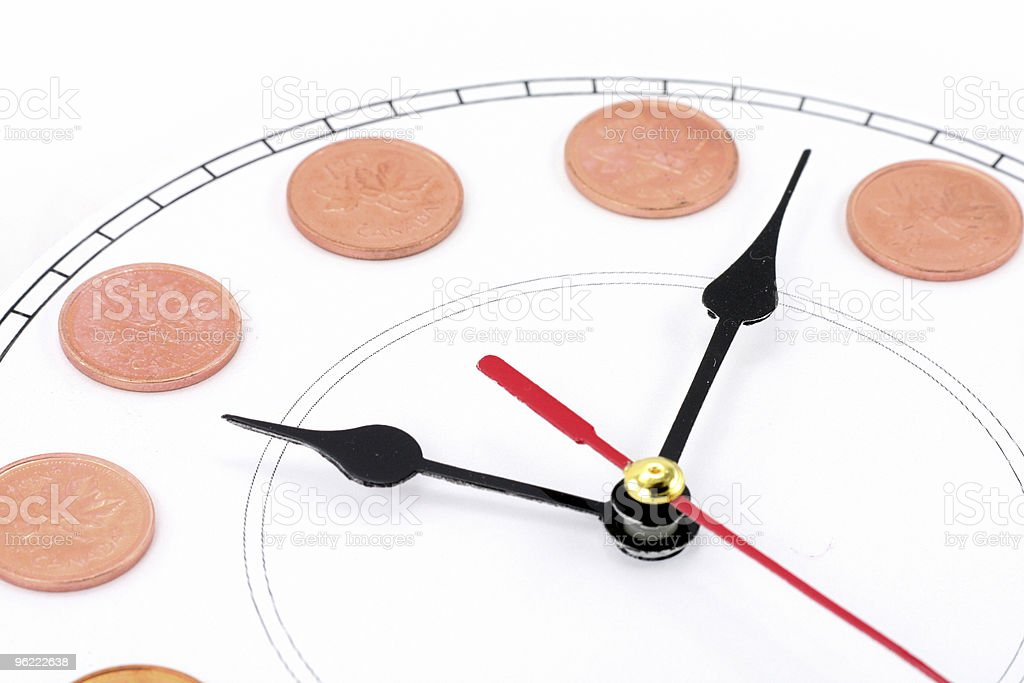 clock and canadian dollars royalty-free stock photo