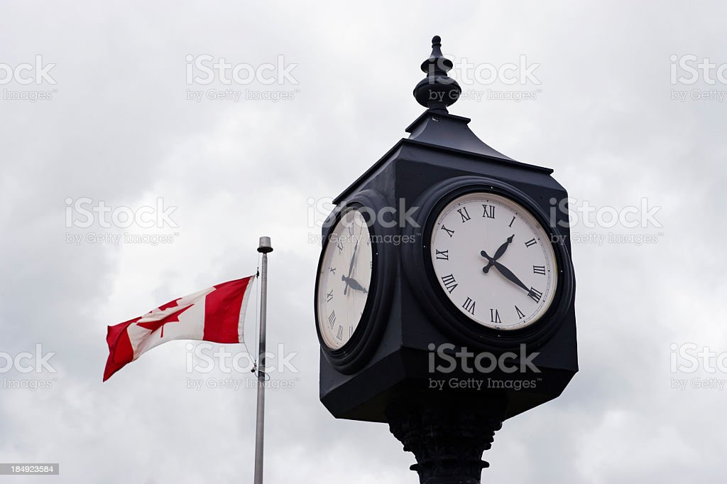 Clock and Canadian flag royalty-free stock photo