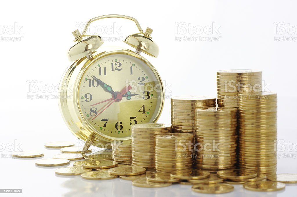 Clock and coins, time is money concept royalty-free stock photo