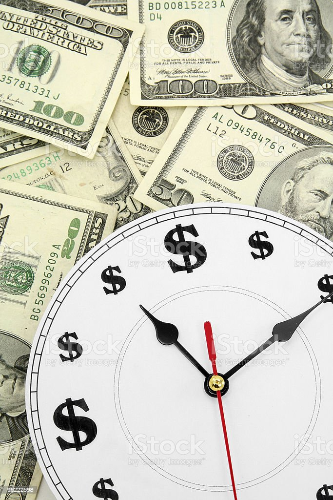 clock and dollars royalty-free stock photo