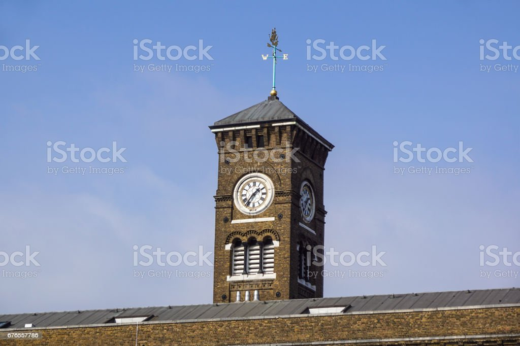clock and facade of Canary Wharf Tower at London city stock photo