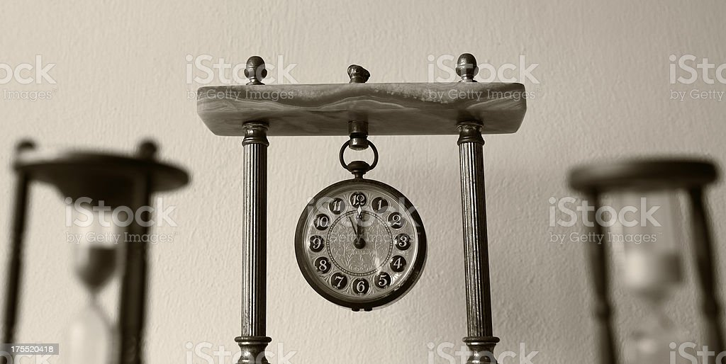 Clock and hourglass royalty-free stock photo