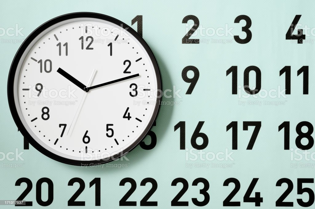 Clock and large blue calendar with shadow royalty-free stock photo