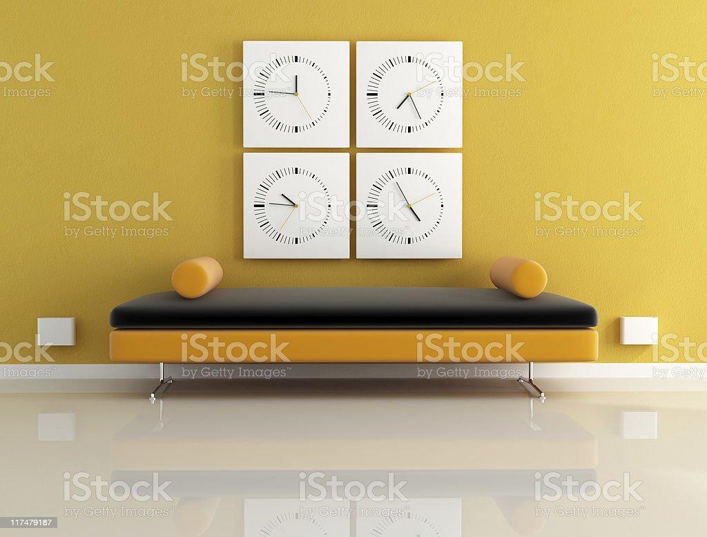clock and orange sofa royalty-free stock photo