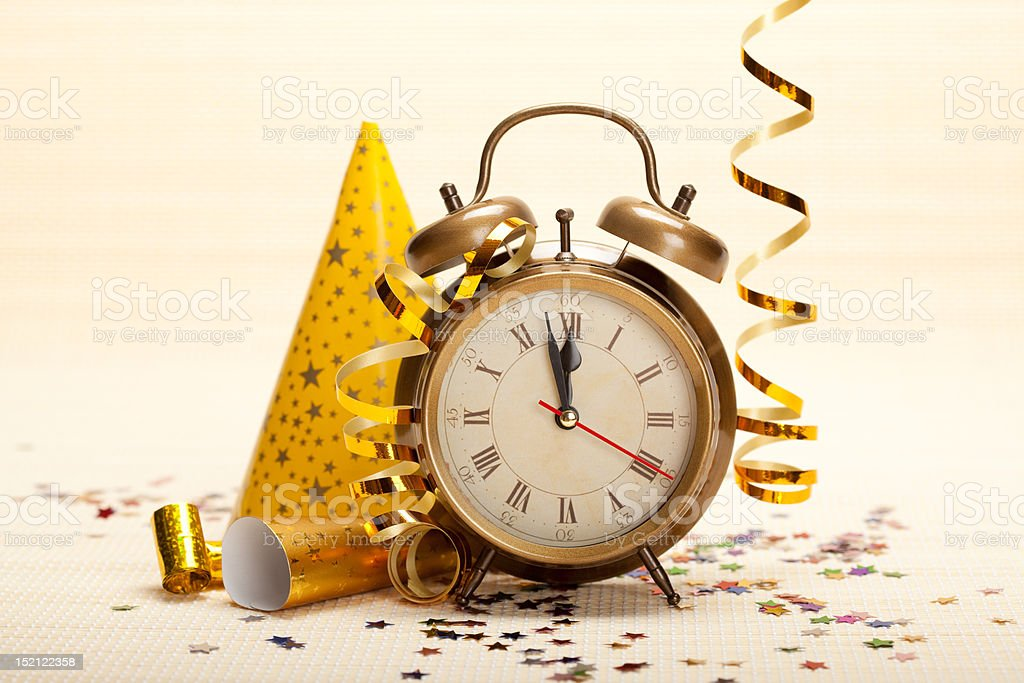 Clock and party decorations royalty-free stock photo