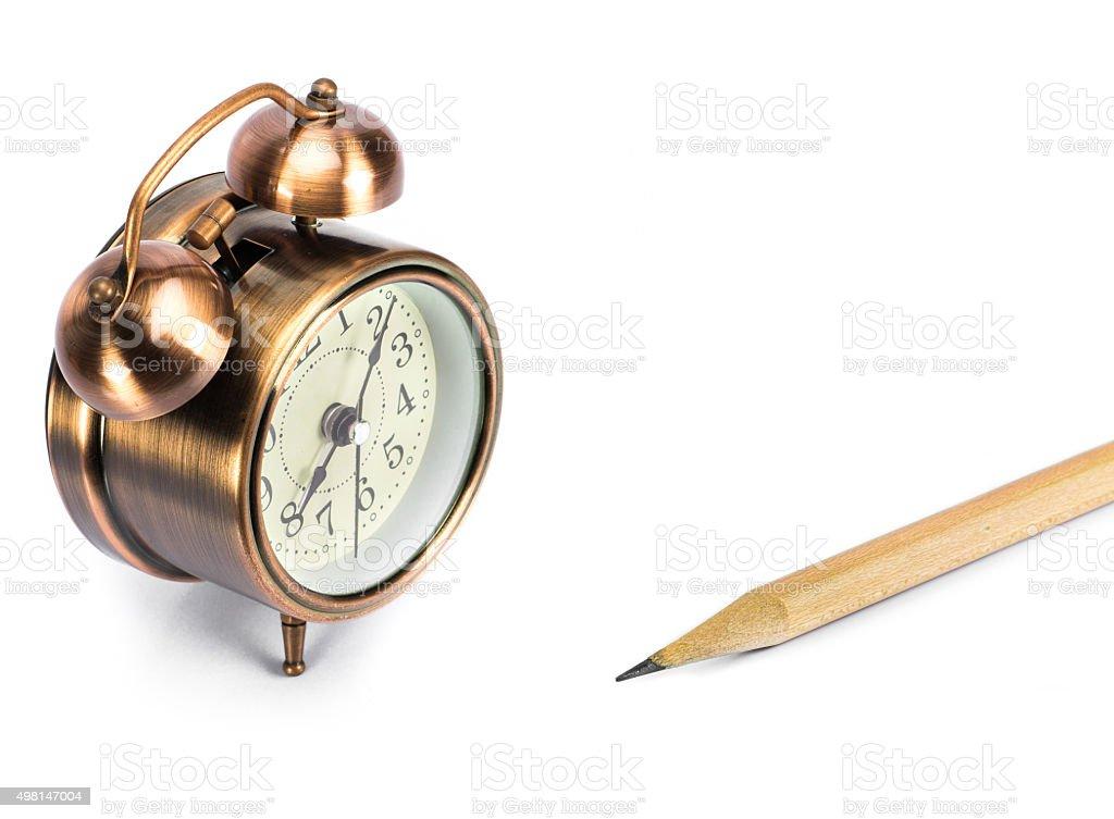 Clock and pencil stock photo