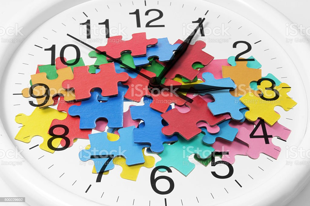 Clock and Puzzle Pieces stock photo