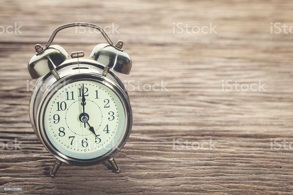 Clock at 5 pm. O'clock in the evening. stock photo
