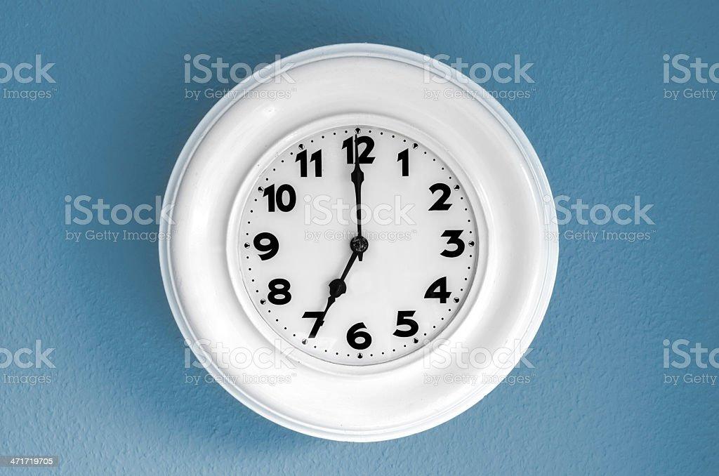 Clock at 7 o'clock royalty-free stock photo