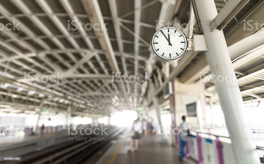 Clock at the sky-train station stock photo
