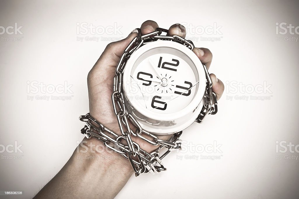 clock chained in a hand royalty-free stock photo
