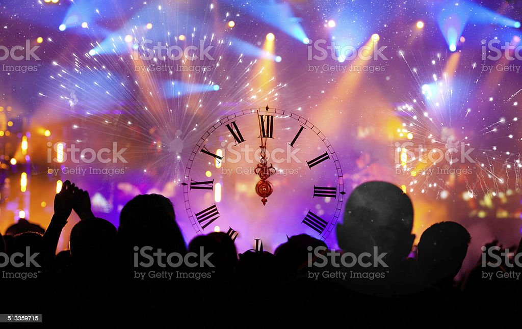 Clock close to midnight, and crowd waiting for New year stock photo