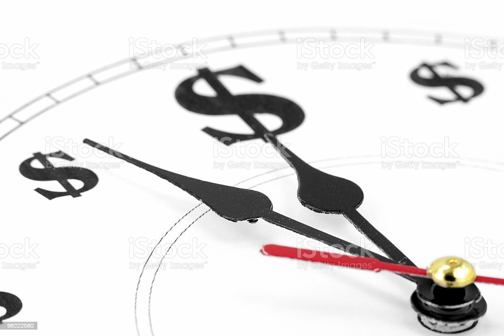 A clock depiction where the numbers turned into dollar signs royalty-free stock photo
