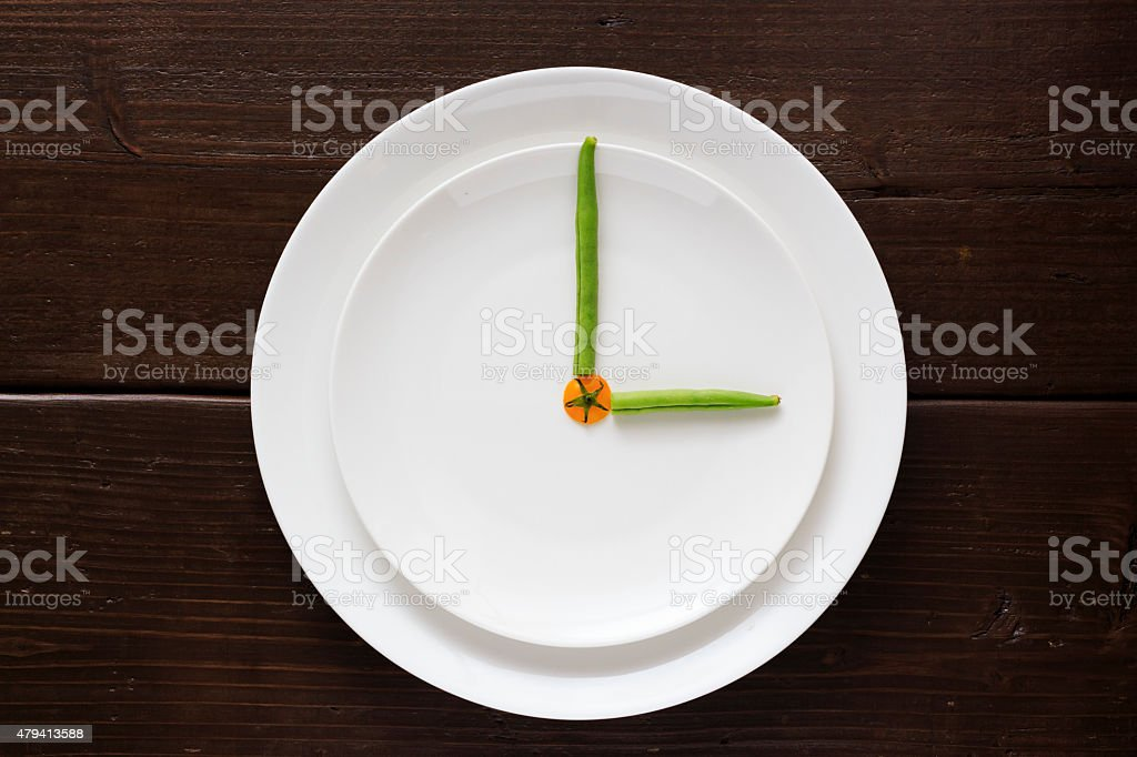 Clock dials made by vegetable stock photo