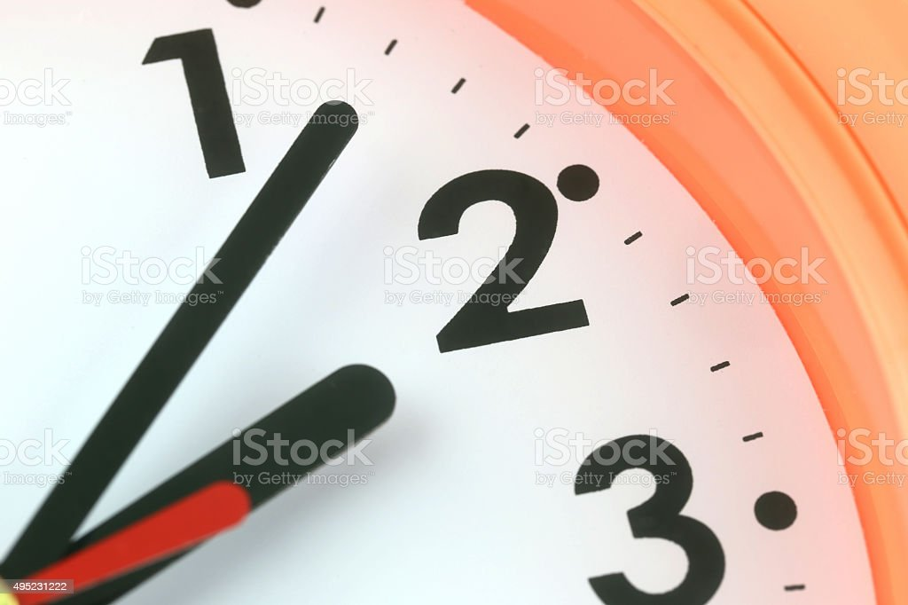 Clock face in time concept. stock photo