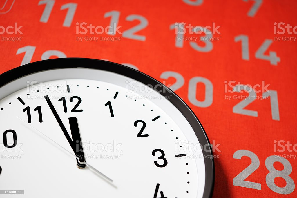 Clock face of deadline against large red calendar stock photo