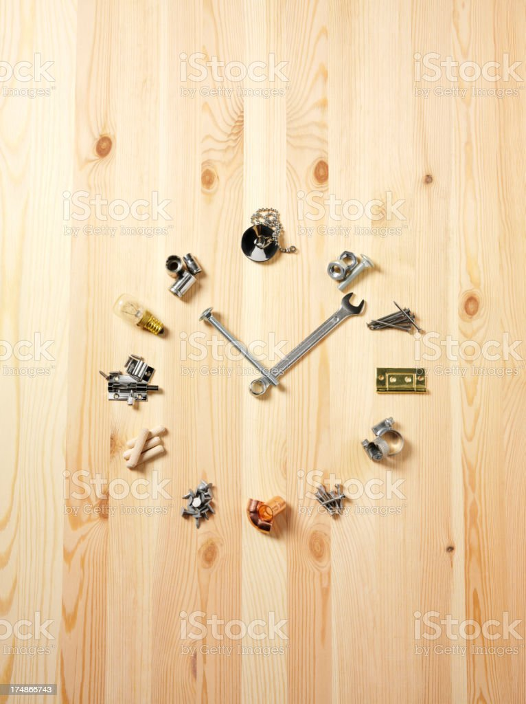 Clock Face on Wood Made from Work Tools stock photo