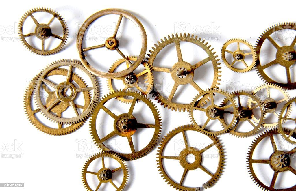 Clock gears on a white background stock photo