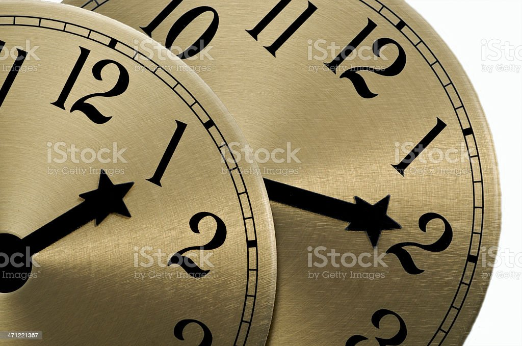 Clock Gold Faces Daylight Savings Time Black Numbers One Two stock photo