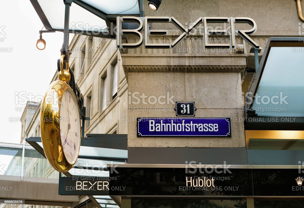Clock hanging on the wall of a shop on Bahnhofstrasse in Zurich,...