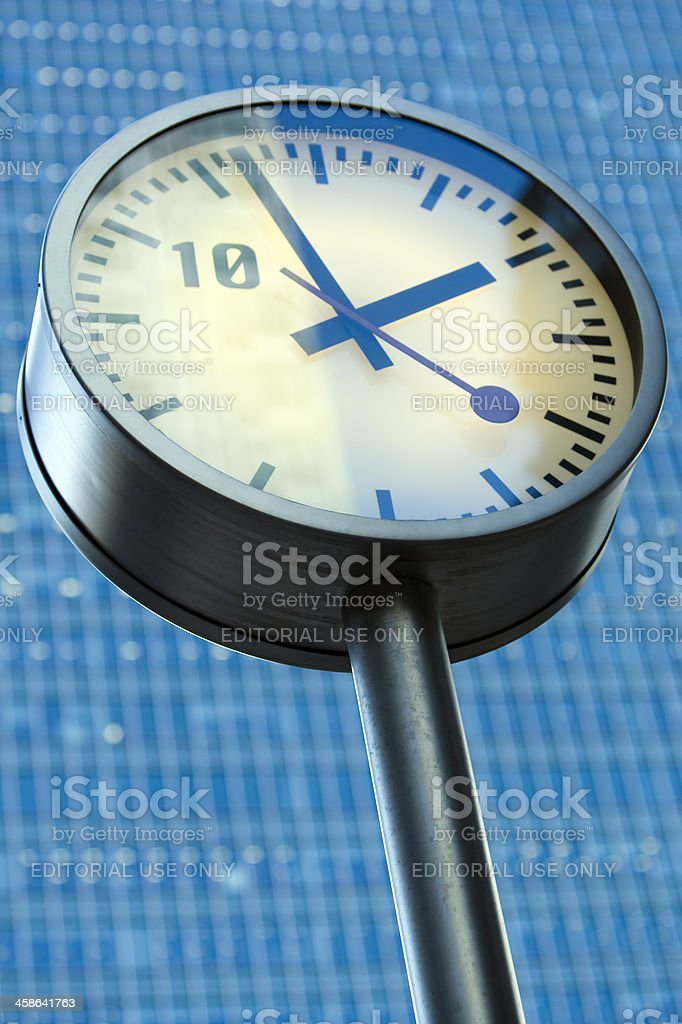 Clock in front of an office building, Canary Wharf, London stock photo