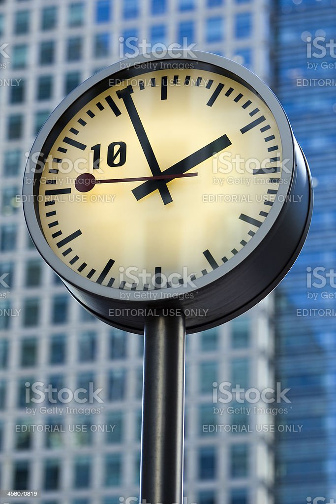 Clock in front of Business Tower, Canary Wharf, London stock photo
