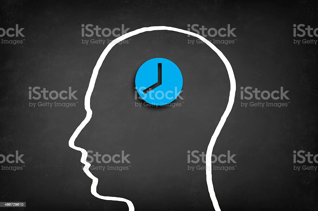 Clock in head stock photo