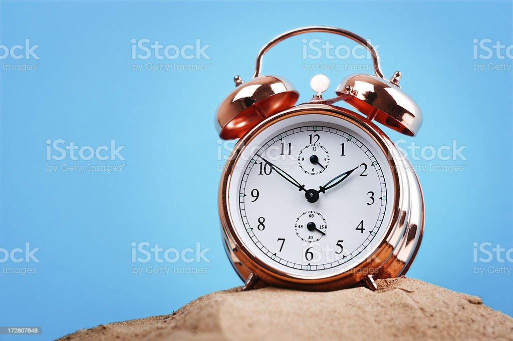 Clock in sand royalty-free stock photo