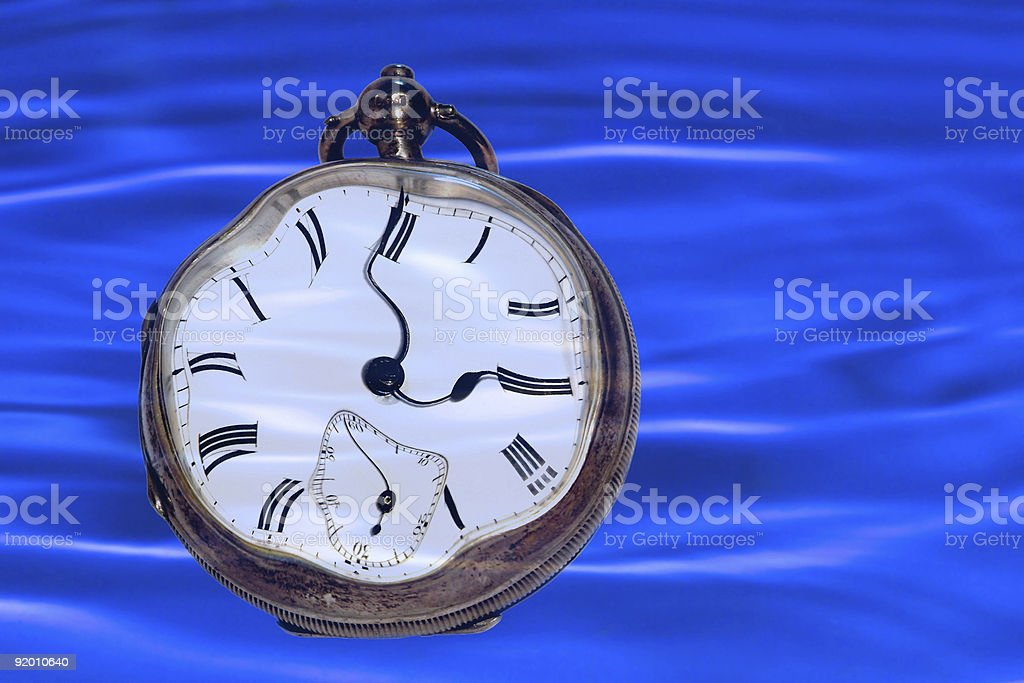 clock in the water time and stress concept royalty-free stock photo