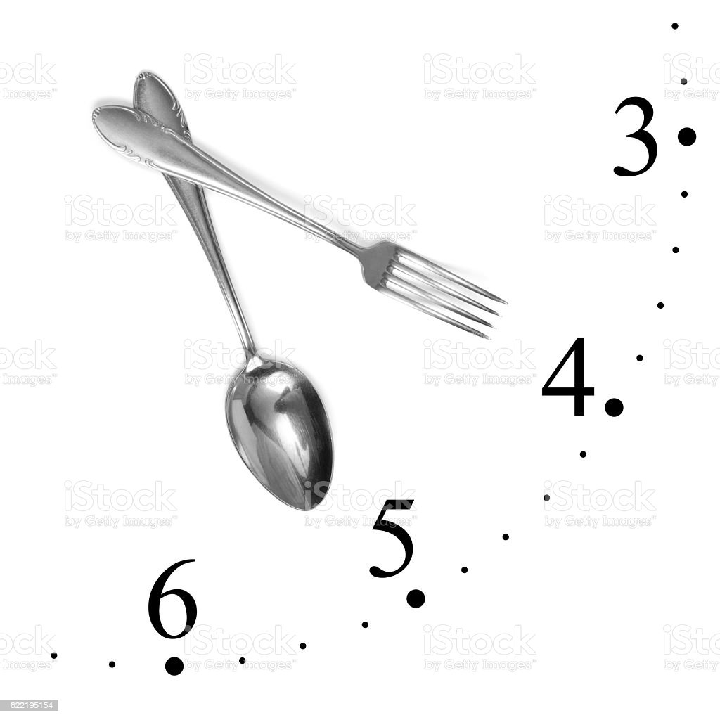 Clock made of fork and spoon stock photo