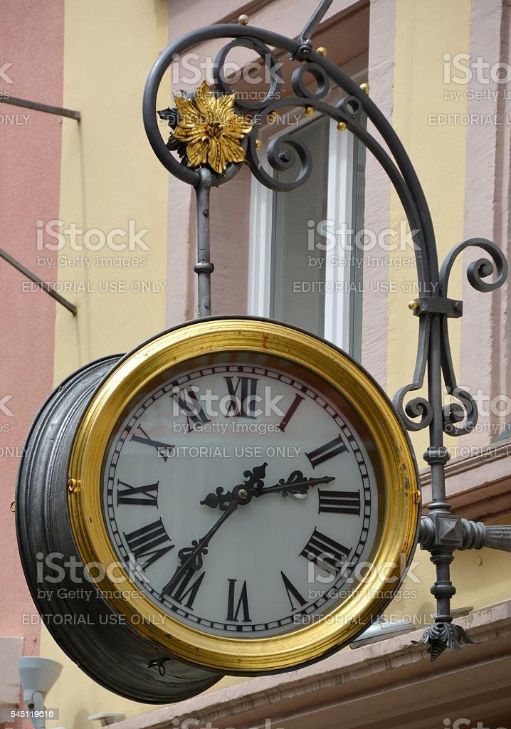 Clock maker advertising stock photo