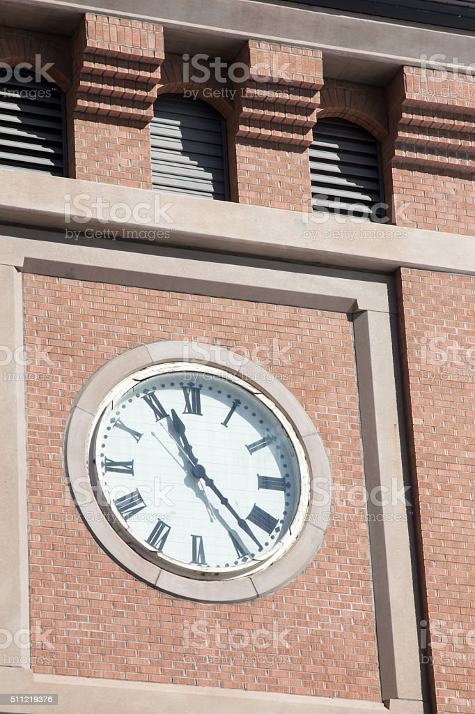 Clock on a brick tower, close up stock photo
