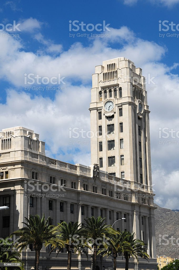 Clock on a Brown Tower stock photo