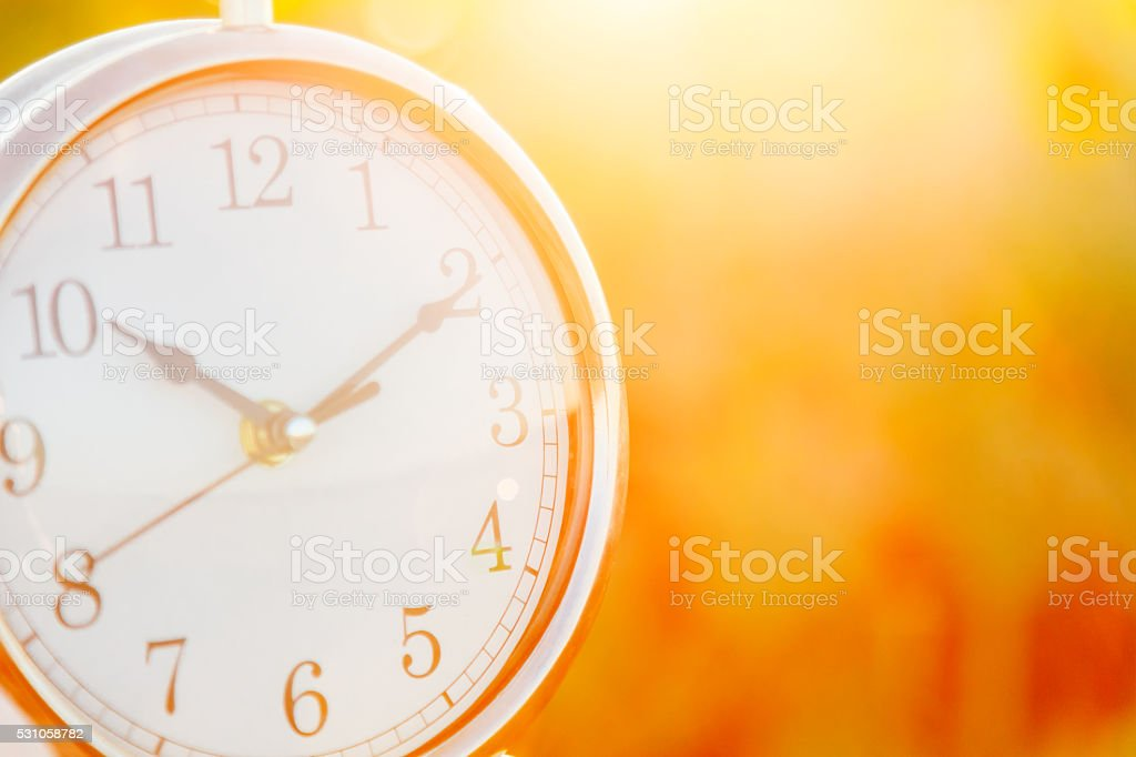 Clock on a sunset background close up stock photo
