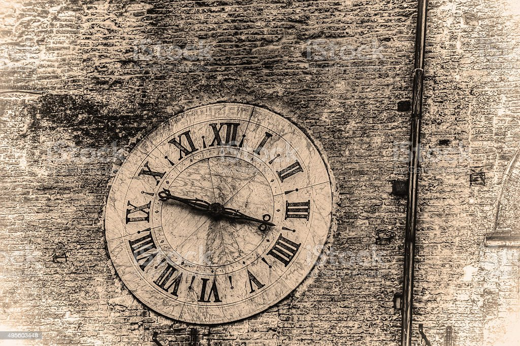 clock on a wall in retro tone stock photo