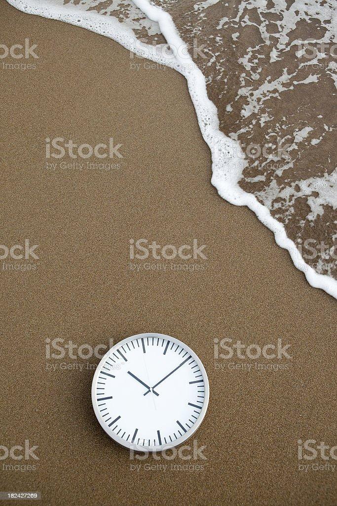 Clock on beach royalty-free stock photo