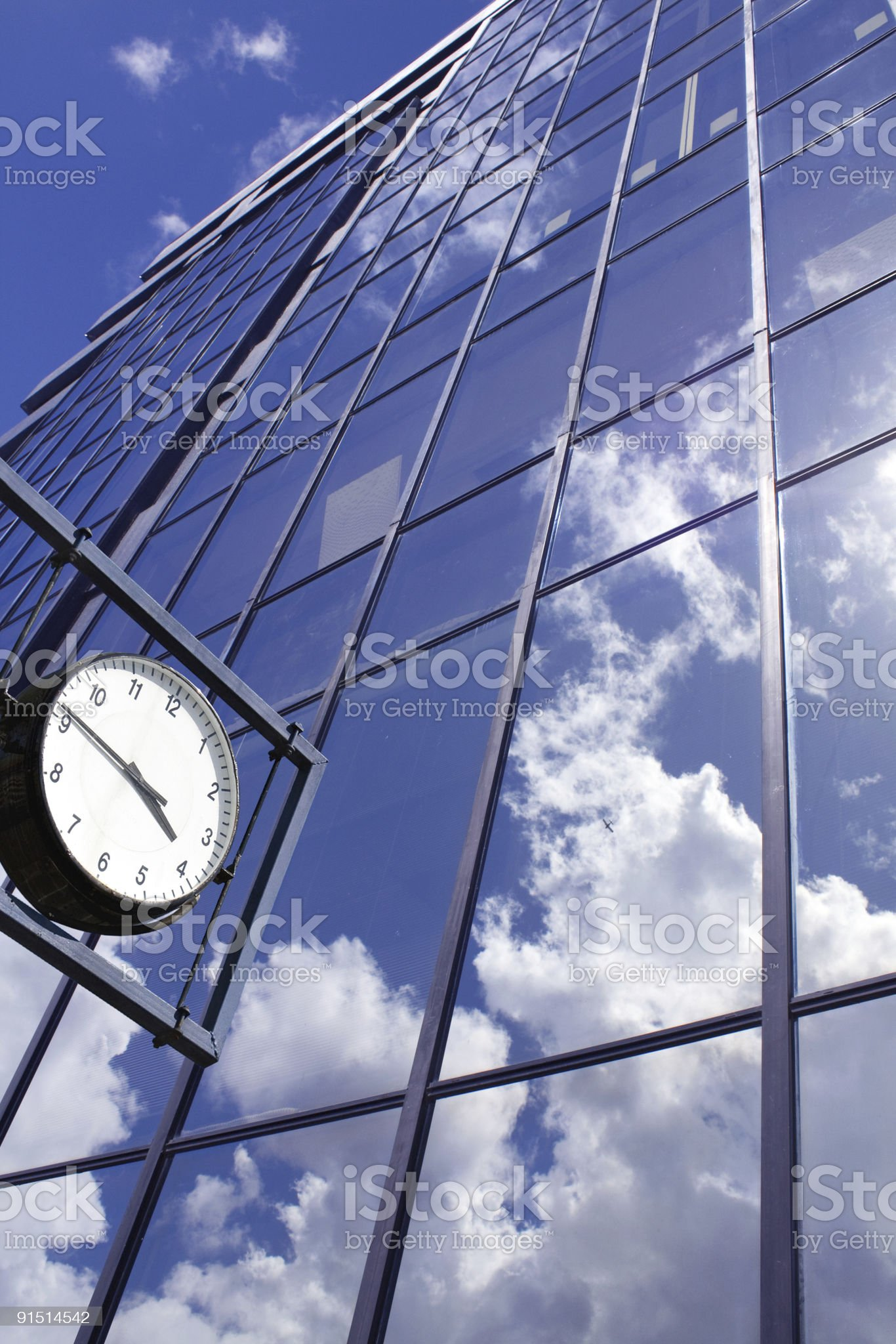 Clock on blue office building background royalty-free stock photo