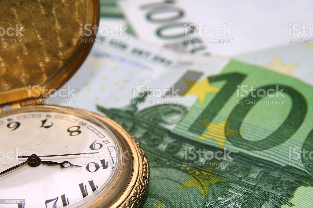 Clock on euros royalty-free stock photo