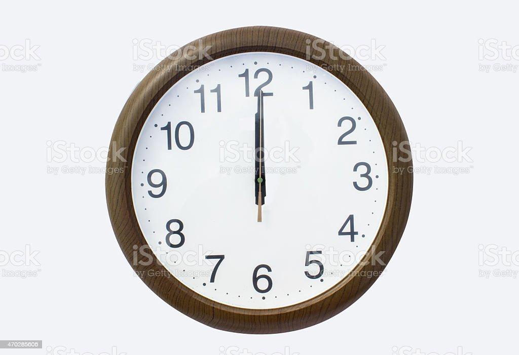 Clock on isolated white - it's 12 o'clock stock photo