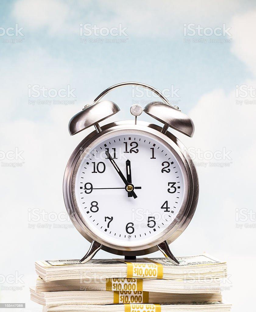 Clock on money stock photo