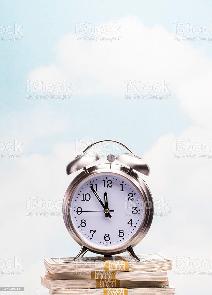 Clock on money royalty-free stock photo