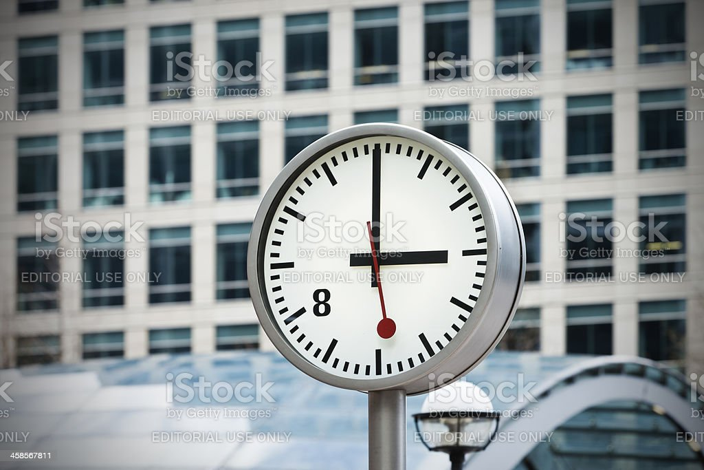 Clock on One Canada Square in London stock photo