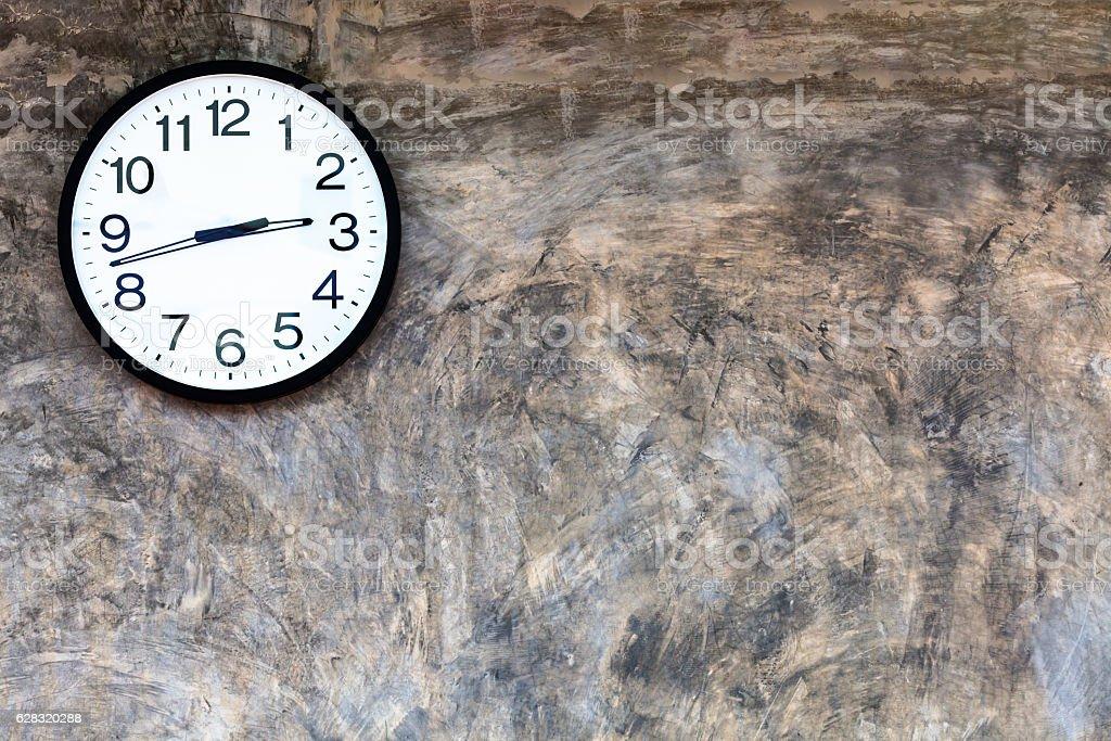 Clock on polished plaster walls stock photo