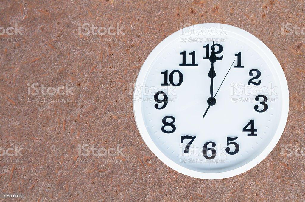 Clock on steel rusty background stock photo