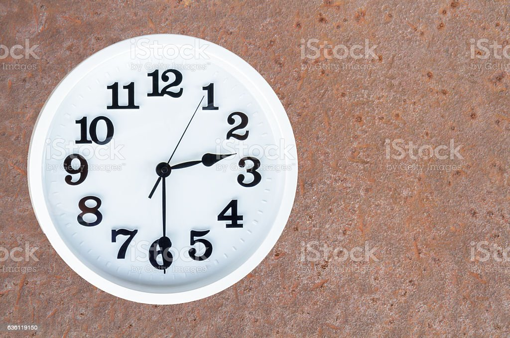 Clock on steel rusty background stock photo