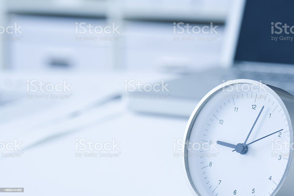 Clock on the desk stock photo